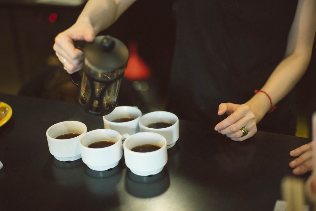 Intern Pouring Coffee