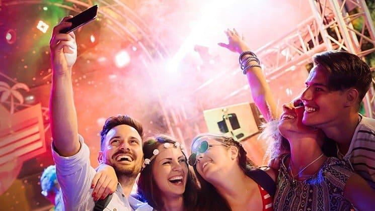 clubgoers taking selfie shutterstock